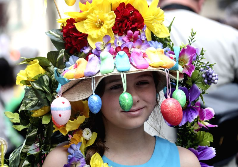 NEW YORK, April 17, 2017 - A girl with elaborately-decorated bonnet takes part in the Easter Bonnet Parade in New York, the United States, April 16, 2017. Each year on Easter, New Yorkers show off ...