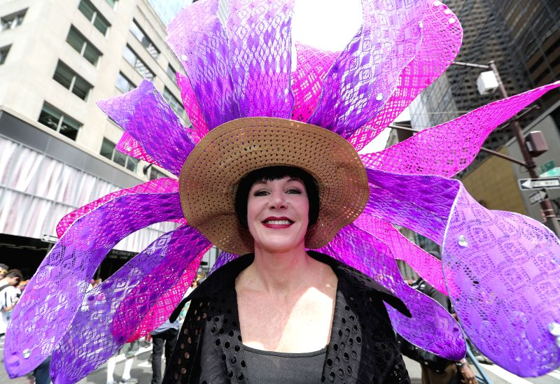 NEW YORK, April 17, 2017 - A woman with elaborately-decorated bonnet takes part in the Easter Bonnet Parade in New York, the United States, April 16, 2017. Each year on Easter, New Yorkers show off ...