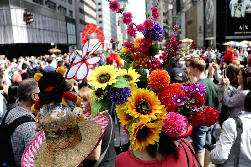 NEW YORK, April 17, 2017 - People with elaborately-decorated bonnets take part in the Easter Bonnet Parade in New York, the United States, April 16, 2017. Each year on Easter, New Yorkers show off ...