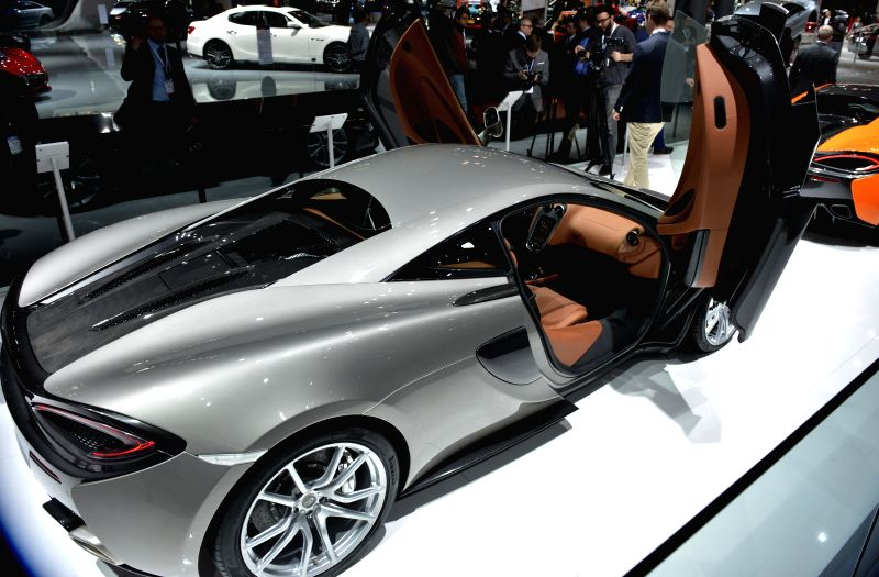 A Mclaren super car is displayed at the New York International Auto Show in New York, the United States, April 2, 2015. A new breed of supercars that are said to ...