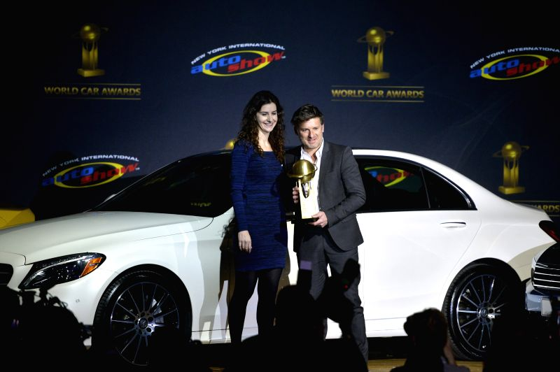Alexandre Malval, Design Director of Citroen, accepts the award for 2015 World Car Design of the Year on behalf of the Citroen C4 Cactus at the New York ...