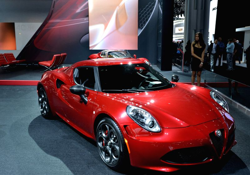 An Alfa Romeo sports car is displayed at the New York International Auto Show in New York, the United States, April 2, 2015. A new breed of supercars that are said ...