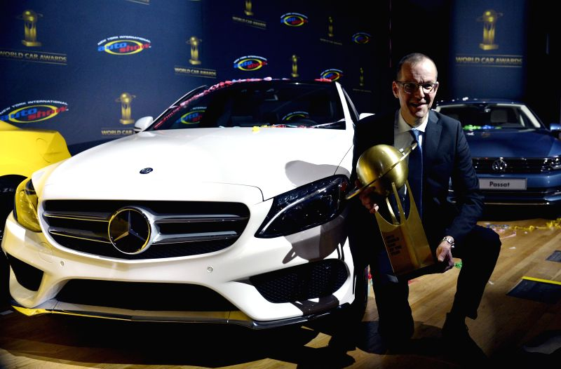 Christoph Horn, Director of Global Communications for Mercedes-Benz, accepts the award for 2015 Car of the Year on behalf of the Mercedes-Benz C-Class at the New ...