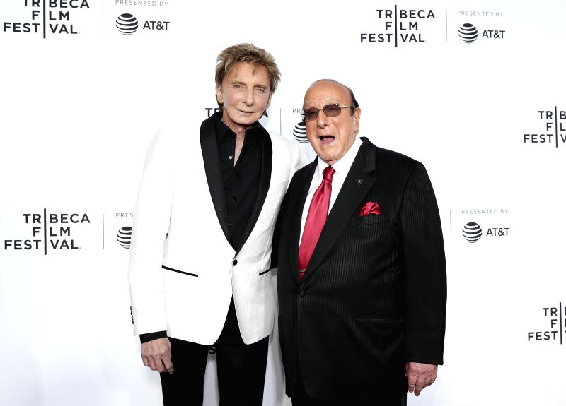 "NEW YORK, April 20, 2017 - Singer Barry Manilow (L) and music mogul Clive Davis attend the opening night of the 2017 Tribeca Film Festival and the world premiere of ""Clive Davis: The Soundtrack ..."
