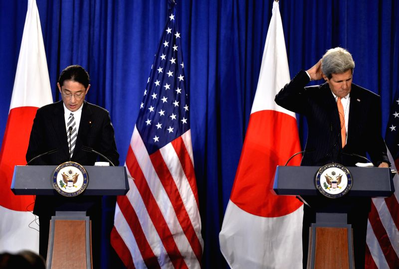 U.S. Secretary of State John Kerry (R) and Japanese Foreign Minister Fumio Kishida attend a press conference in New York, the United States, on April 27, 2015. ... - Fumio Kishida