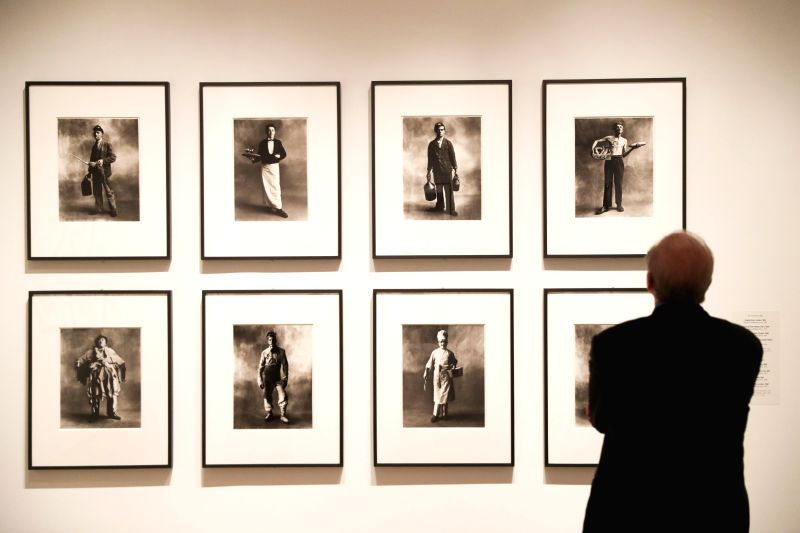 NEW YORK, April 27, 2017 - A visitor views photos taken by Irving Penn, at a photo exhibition in the Metropolitan Museum of Art in New York, the United States, April 26, 2017. The photo exhibition ...