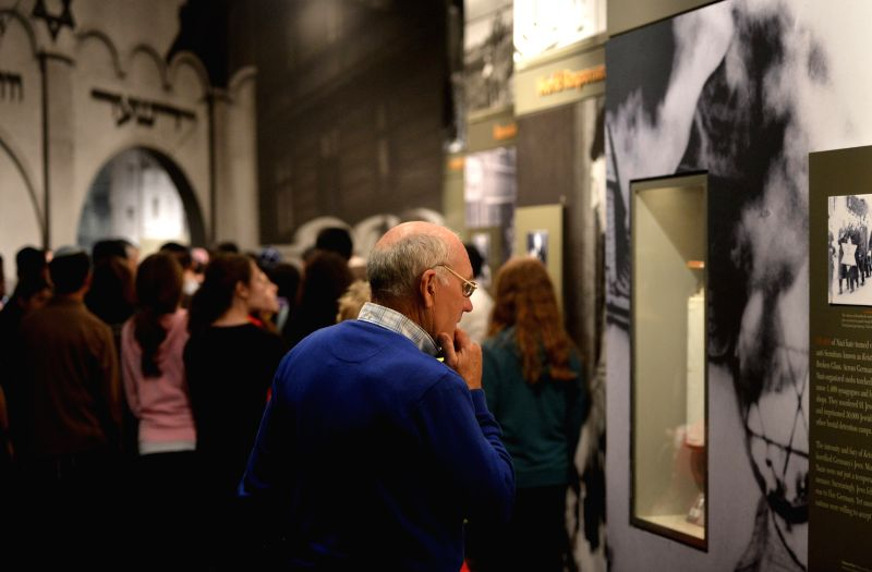A visitor watches exhibits about hisitory of Holocaust in the Museum of Jewish Heritage in New York City, the United States, on April 28, 2014. An event named ...