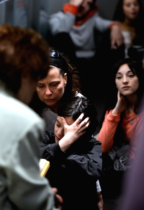 A woman and her daughter listen to a Holocaust survivor in the Museum of Jewish Heritage in New York City, the United States, on April 28, 2014. An event named ...