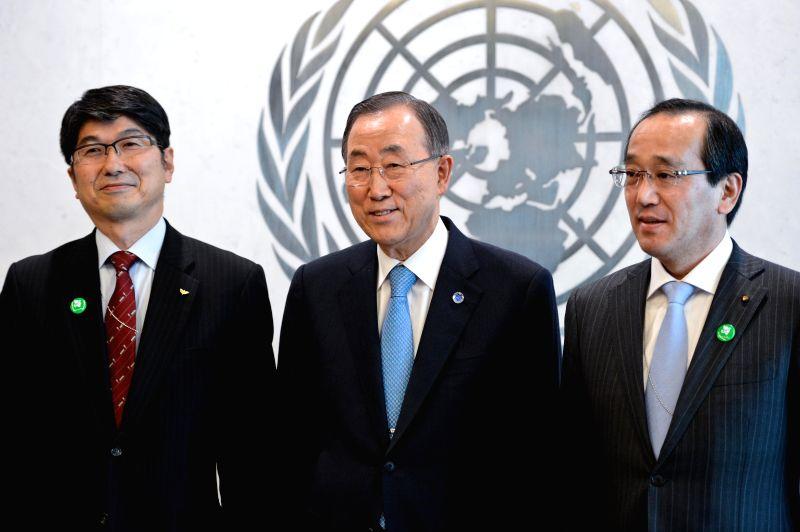 United Nations Secretary-General Ban Ki-moon (C) poses for a picture with Kazumi Matsui (R), mayor of Hiroshima, and Tomihisa Taue, mayor of Nagasaki, before ...