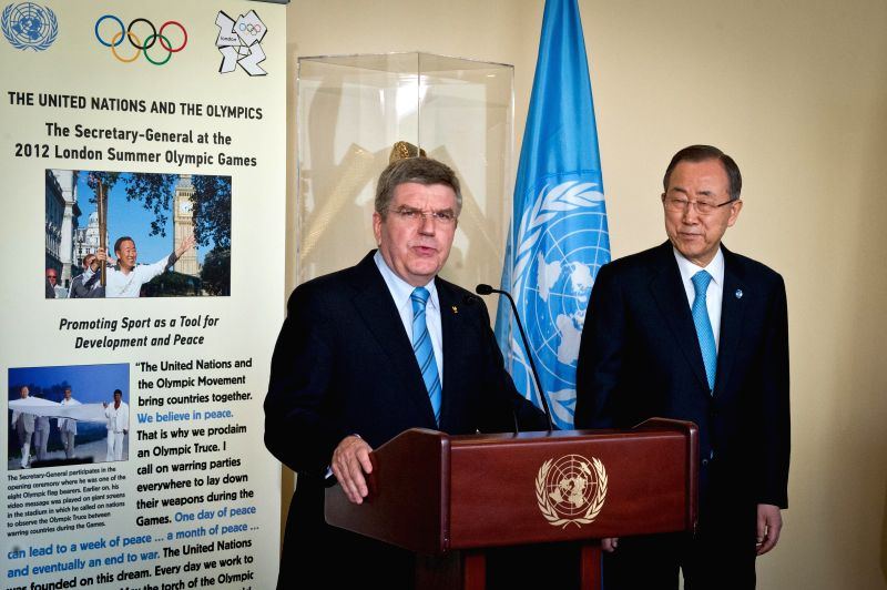 International Olympic Committee chief Thomas Bach (L) speaks to media reporters as United Nations Secretary-General Ban Ki-moon looks on at the UN headquarters in