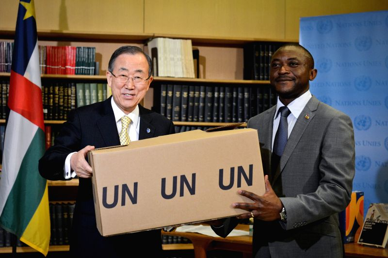 United Nations Secretary-General Ban Ki-moon (L) hands over a box containing UN docoments to Mesmin Dembassa Worogagoi, charge d'affaires of the Central African ..