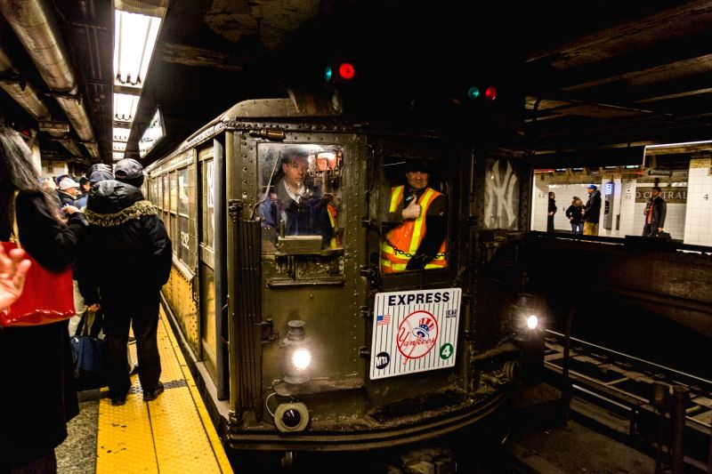 "NEW YORK, April 5, 2016 - A ""Nostalgia Special"" train conductor gives a thumbs-up gesture to baseball fans waiting for the train ride at the Grand Central subway station in New York, the ..."