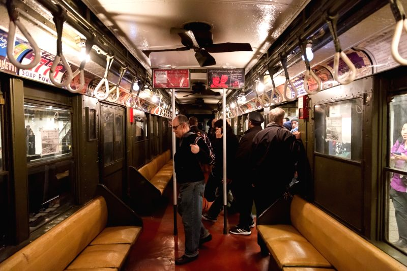 "NEW YORK, April 5, 2016 - Baseball fans board the ""Nostalgia Special"" train at the Grand Central subway station in New York, the United States, April 5, 2016. The New York Metropolitan ..."