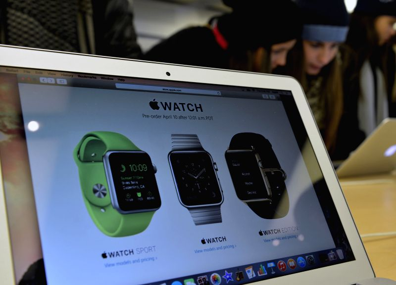 Customers test Apple products at Apple flag store in Manhattan, New York, the United States, on April 9, 2015. Apple Watch, the first Apple product to be worn, ...