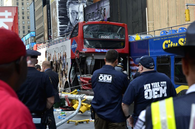 The collided double-decker sightseeing buses are seen at Times Square, New York City, the United States, on Aug. 5, 2014. Two sightseeing buses crashed at the ...