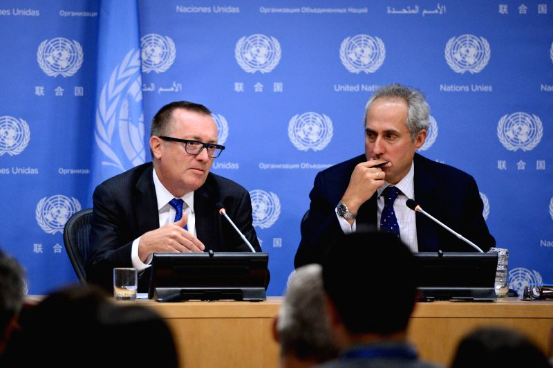 UN Under Secretary-General for Political Affairs Jeffrey Feltman (L) speaks as UN spokesman Stephane Dujarric looks on during a press briefing at the UN ...