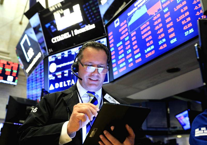 NEW YORK, Aug. 1, 2019 (Xinhua) -- A trader works at the New York Stock Exchange in New York, the United States, Aug. 1, 2019. U.S. stocks ended lower on Thursday, as investors digested a batch of negative data that pointed to slowing U.S. economic a