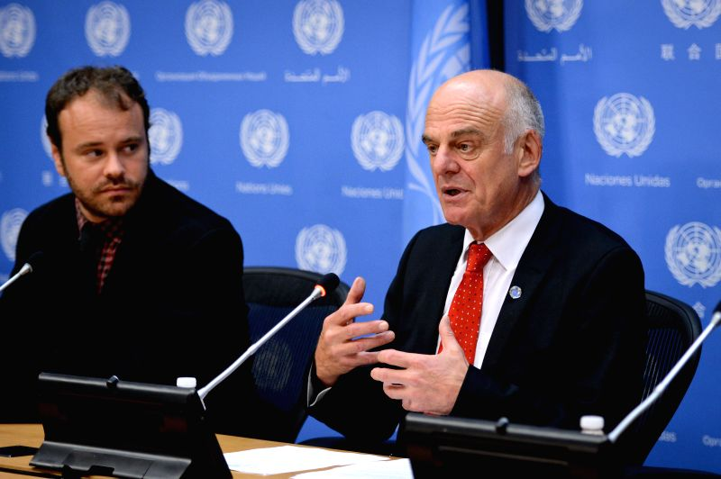 David Nabarro(R), the UN system coordinator on Ebola Virus, speaks during a press briefing at the UN headquarters in New York, on August 19, 2014. David Nabarro, ..