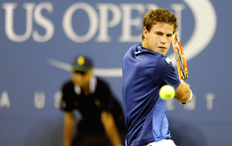 Diego Schwartzman of Argentina returns a shot during the men's singles 1st round match against Novak Djokovic of Serbia at the U.S. Open tennis tournament in New ..