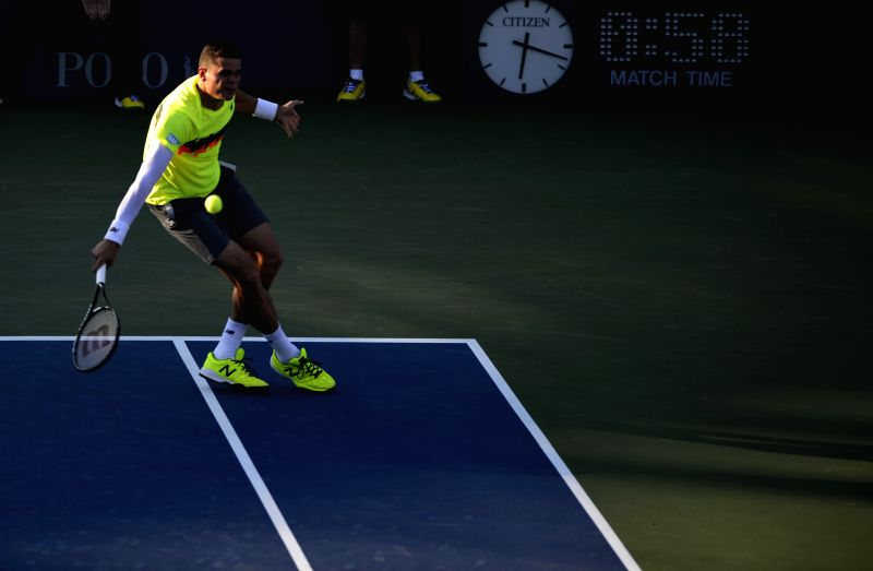 Milos Raonic of Canada competes during the men's singles 1st round match agasint Taro Daniel of Japan at the U.S. Open tennis tournament in New York, the United ...
