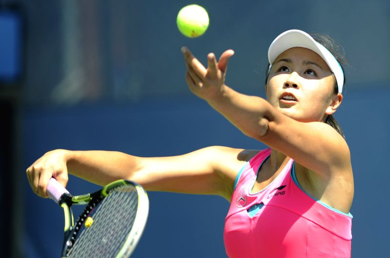 Peng Shuai of China serves during the women's singles 1st round match against her compatriot Zheng Jie at the U.S. Open tennis tournament in New York, the United ..