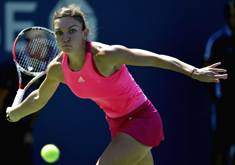 Simona Halep of Romania competes during the women's singles 1st round match against Danielle Rose Collins of the United States at the U.S. Open tennis tournament ..
