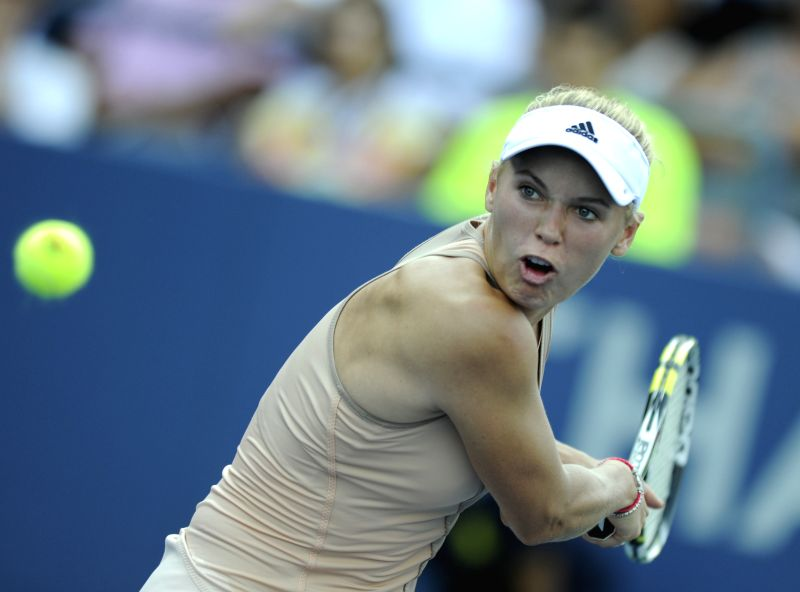 Caroline Wozniacki of Denmark returns the shuttle during the second round match of women's singles against Aliaksandra Sasnovich of Belarus at the 2014 U.S.Open in