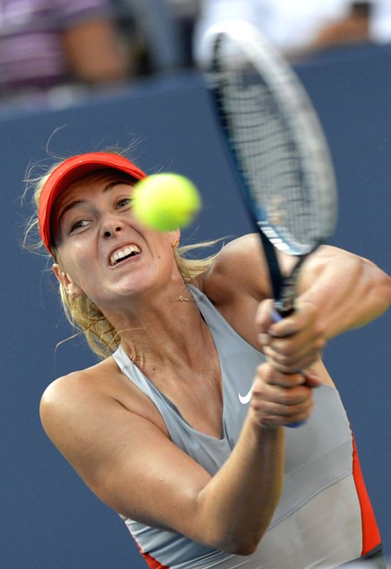 Maria Sharapova of Russia competes against Alexandra Dulgheru of Romania during the women's singles second round match at the U.S. Open tennis tournament in New ...