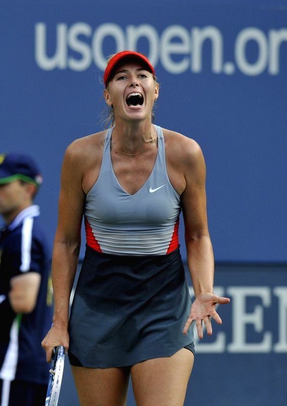 Maria Sharapova of Russia reacts during the women's singles second round match with Alexandra Dulgheru of Romania at the U.S. Open tennis tournament in New York, ..