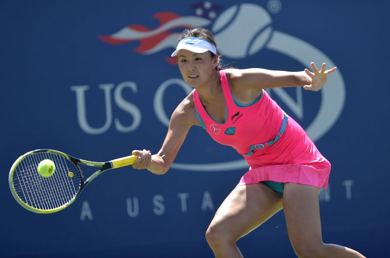 Peng Shuai of China returns the shuttle during the second round match of women's singles against Agnieszka Radwanska of Poland at the 2014 U.S.Open in New York, ...