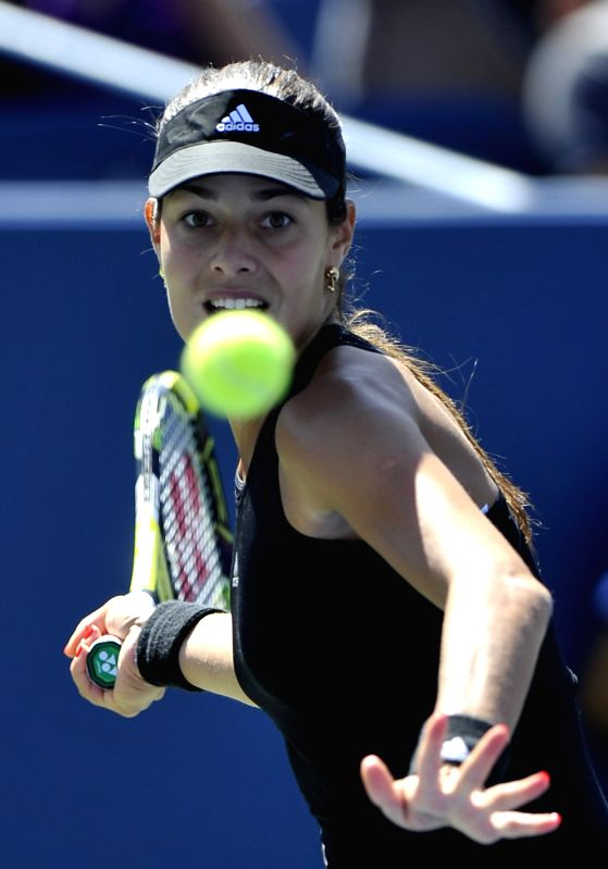 Ana Ivanovic of Serbia returns a shot during the second round match of women's singles against Karolina Pliskova of the Czech Republic at the 2014 U.S. Open in New