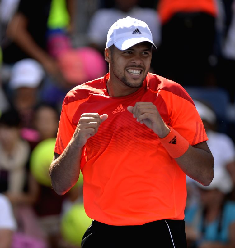 Jo-Wilfried Tsonga of France celebrates after the second round match of men's singles against Aleksandr Nedovyesov of Kazakhstan at the 2014 U.S. Open in New York,