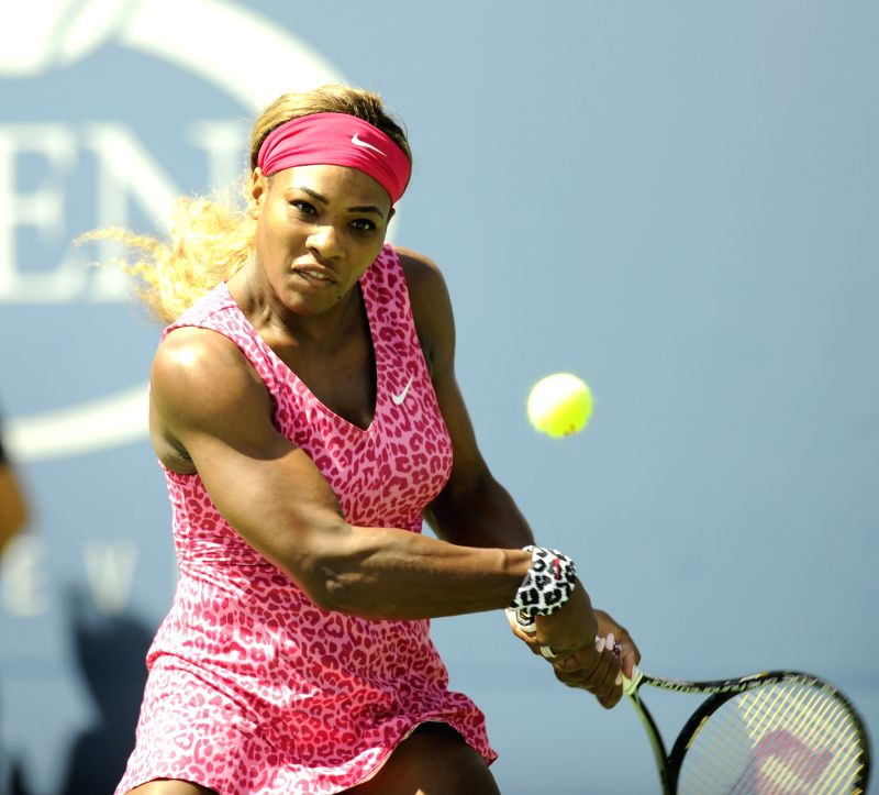 Serena Williams of the Unites States returns a shot during the second round match of women's singles against her compatriot Vania King at the 2014 U.S. Open in New