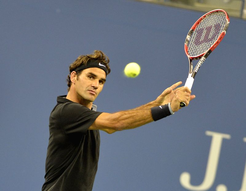 Roger Federer of Switzerland competes during the second round match of men's singles against Sam Groth of Australia at the 2014 U.S. Open in New York Aug. 29, ...