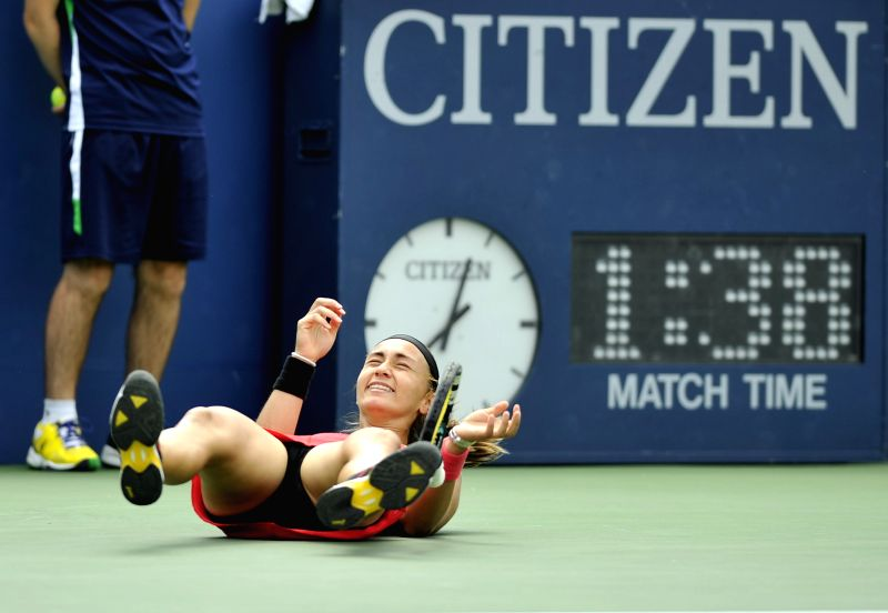 Aleksandra Krunic of Serbia celebrates after winning the third round match of women's singles against Petra Kvitova of the Czech Republic at the 2014 U.S. Open in .