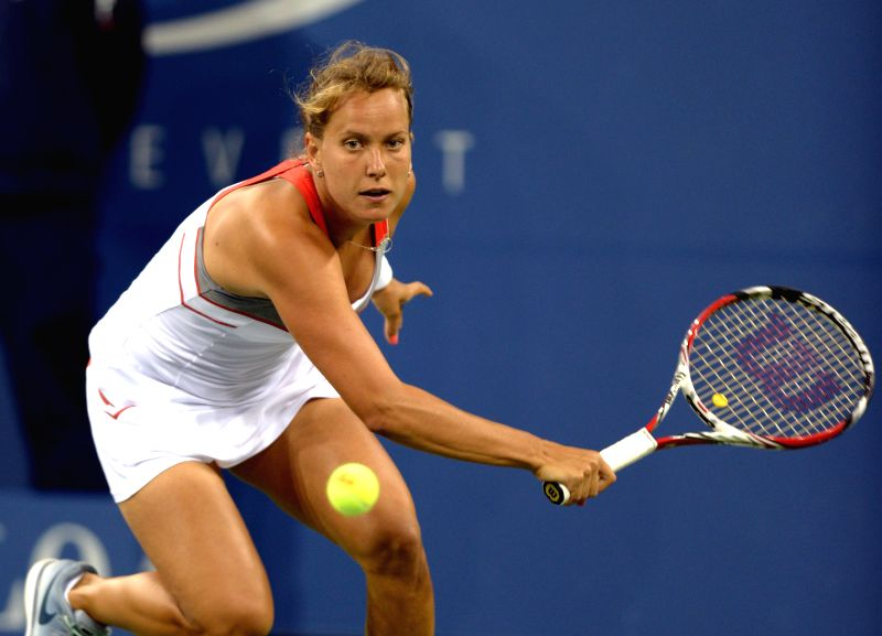 Barbora Zahlavova Strycova of the Czech Republic returns a shot against Eugenie Bouchard of Canada during the third round match of women's singles at the 2014 U.S.