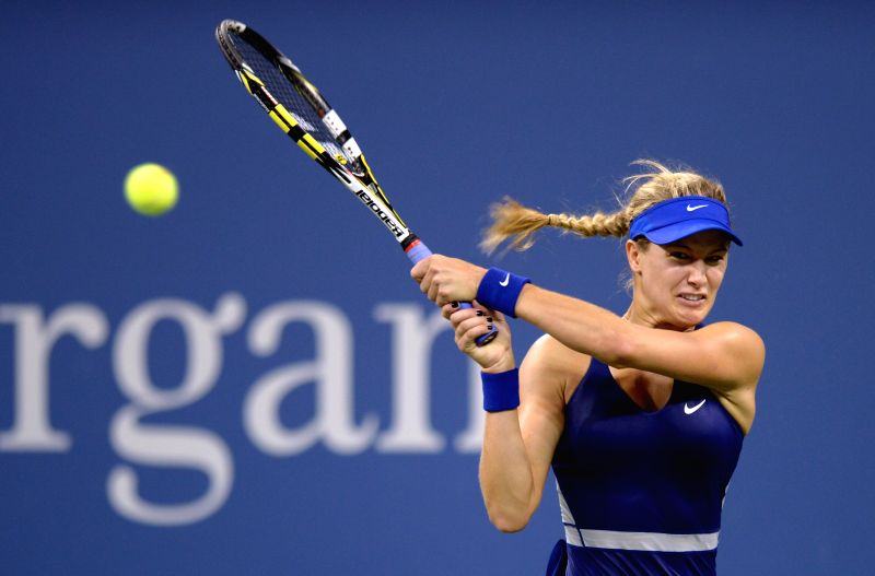 Eugenie Bouchard of Canada returns a shot against Barbora Zahlavova Strycova of the Czech Republic during the third round match of women's singles at the 2014 U.S.