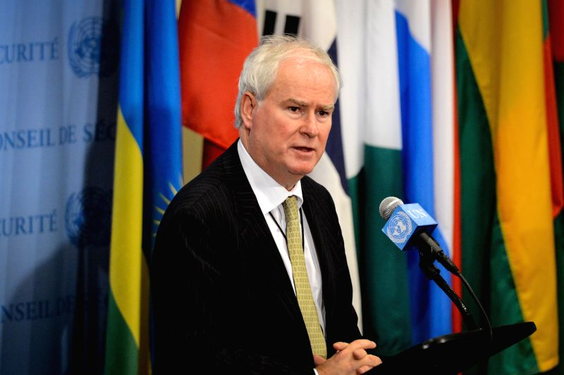 Britain's Ambassador to the United Nations Mark Lyall Grant, who is this month's rotating president of the UN Security Council, reads a press statement about Iraq ..