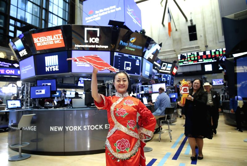 NEW YORK, Aug. 6, 2018 - An actress performs before the opening bell at the New York Stock Exchange in New York, the United States, Aug. 6, 2018. Executives and sponsors of the upcoming 28th Annual ...
