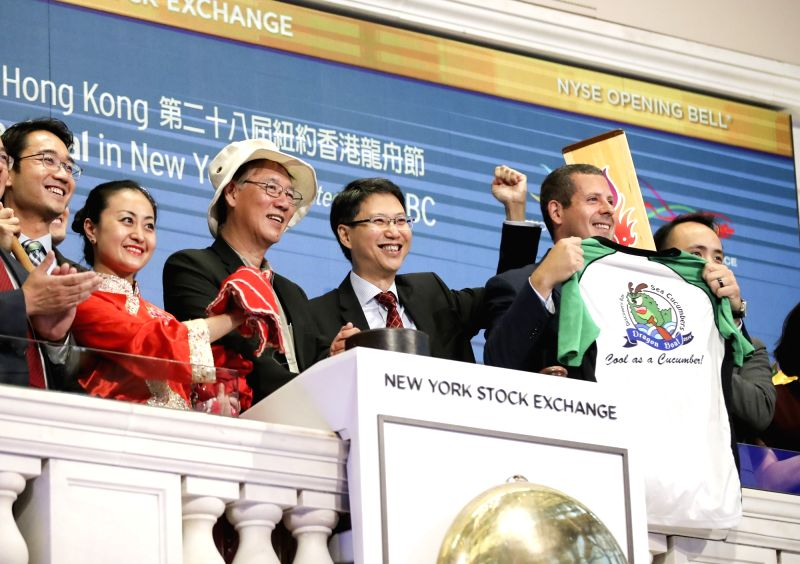 NEW YORK, Aug. 6, 2018 - Eddie Mak (4th L), Commissioner for Economic and Trade Affairs of China's Hong Kong Special Administrative Region Government to the United States, Henry Wan (3rd L), Chairman ...