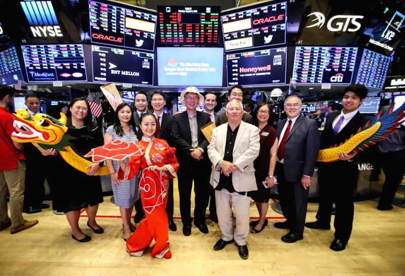NEW YORK, Aug. 6, 2018 - Performers and invited guests pose for a photo on the trading floor after ringing the opening bell at the New York Stock Exchange in New York, the United States, Aug. 6, ...