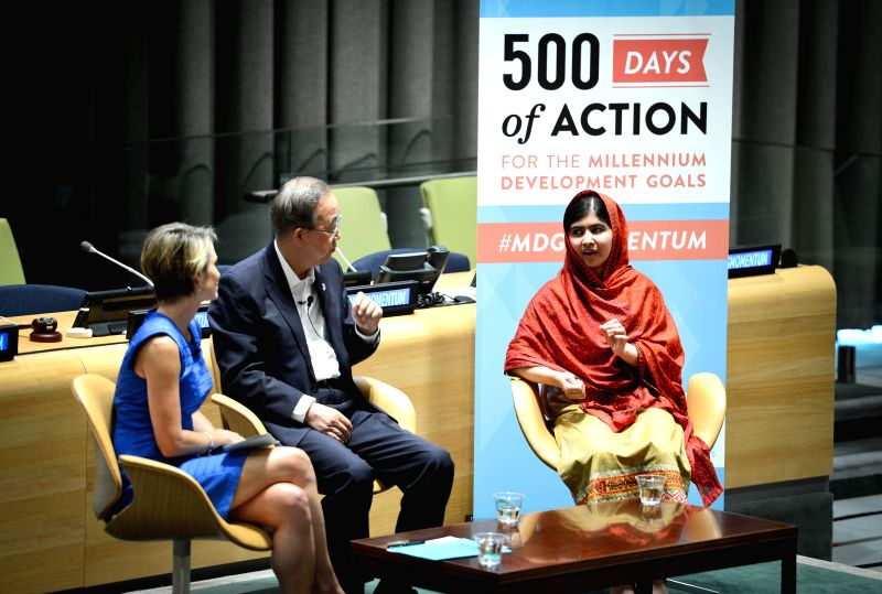 Education advocate Malala Yousafzai (R) speaks as UN Secretary-General Ban Ki-moon (C) and Amy Robach, news anchor with ABC's Good Morning America, listen during a .
