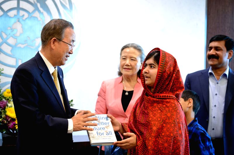 UN Secretary-General Ban Ki-moon (L, front) gives a book as a gift to education advocate Malala Yousafzai (front R) before a special event marking 500 days of ...