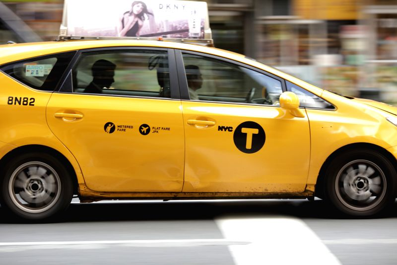 NEW YORK, Aug. 9, 2018 - A yellow cab is seen on a street in Manhattan, New York City, the United States, Aug. 9, 2018. New York City Council passed regulations on for-hire vehicle industry on ...