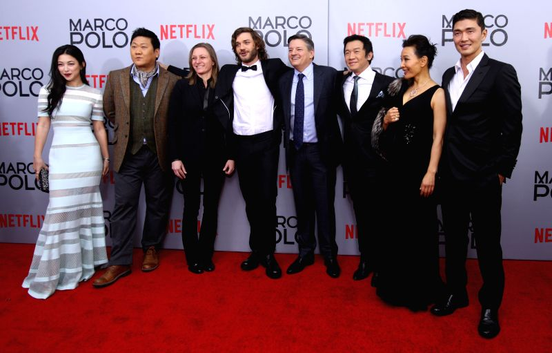 "New York: Cast members and producers of the new Netflix series ""Marco Polo"" pose for group photos before the series' premiere at AMC Lincoln Square in New York, the United States, on Dec. .."