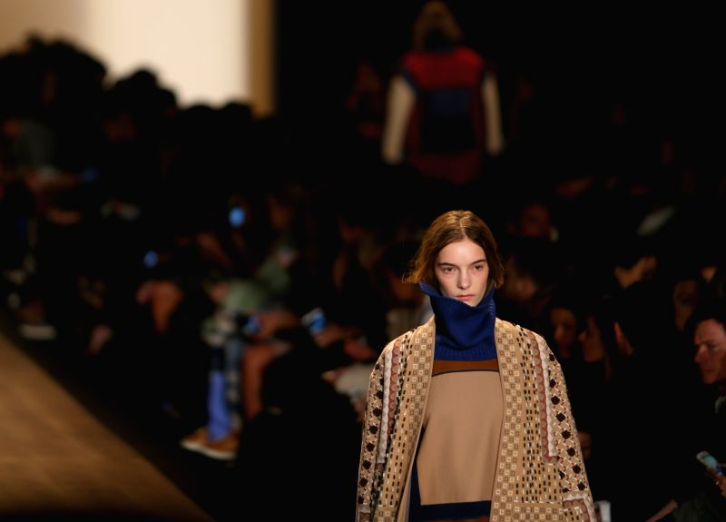 A model presents a creation of the Fall/Winter 2015 BCBGMAXAZRIA collection during the New York Fashion Week in New York, the United States, on Feb. 12, 2015. ...