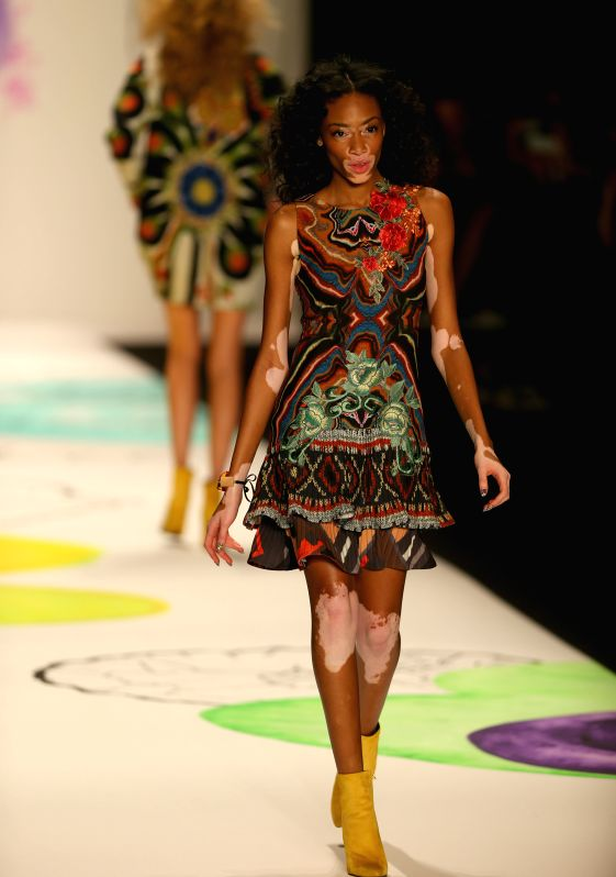 A model presents a creation of the Fall/Winter 2015 Desigual collection during the New York Fashion Week in New York, the United States, on Feb. 12, ...