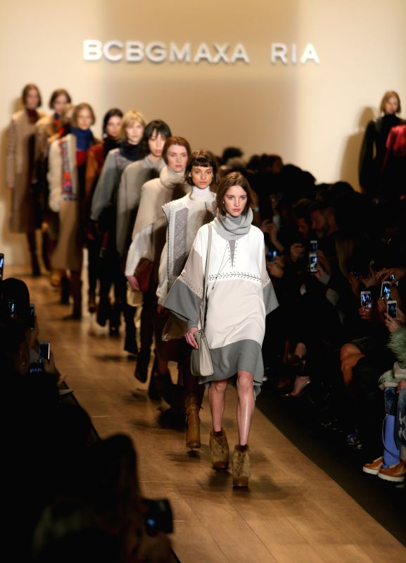 Models present creations of the Fall/Winter 2015 BCBGMAXAZRIA collection during the New York Fashion Week in New York, the United States, on Feb. 12, 2015. ...
