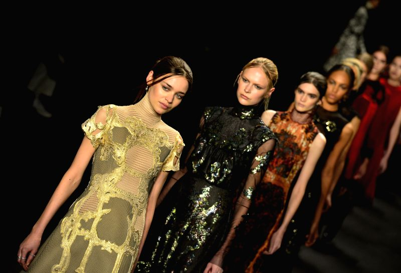Models present creations of Vivienne Tam during the New York Fashion Week in New York, the United States, on Feb. 16, 2015.