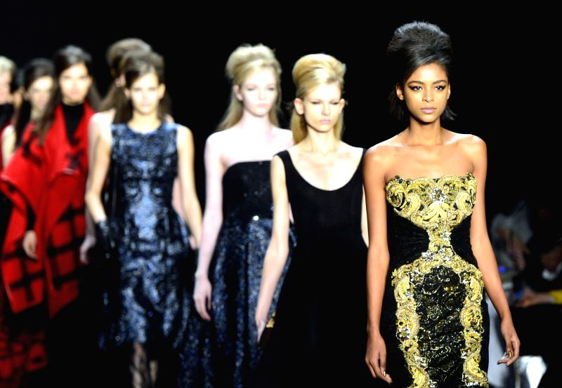 Models present creations of Badgley Mischka during the New York Fashion Week in New York, the United States, on Feb. 17, 2015.